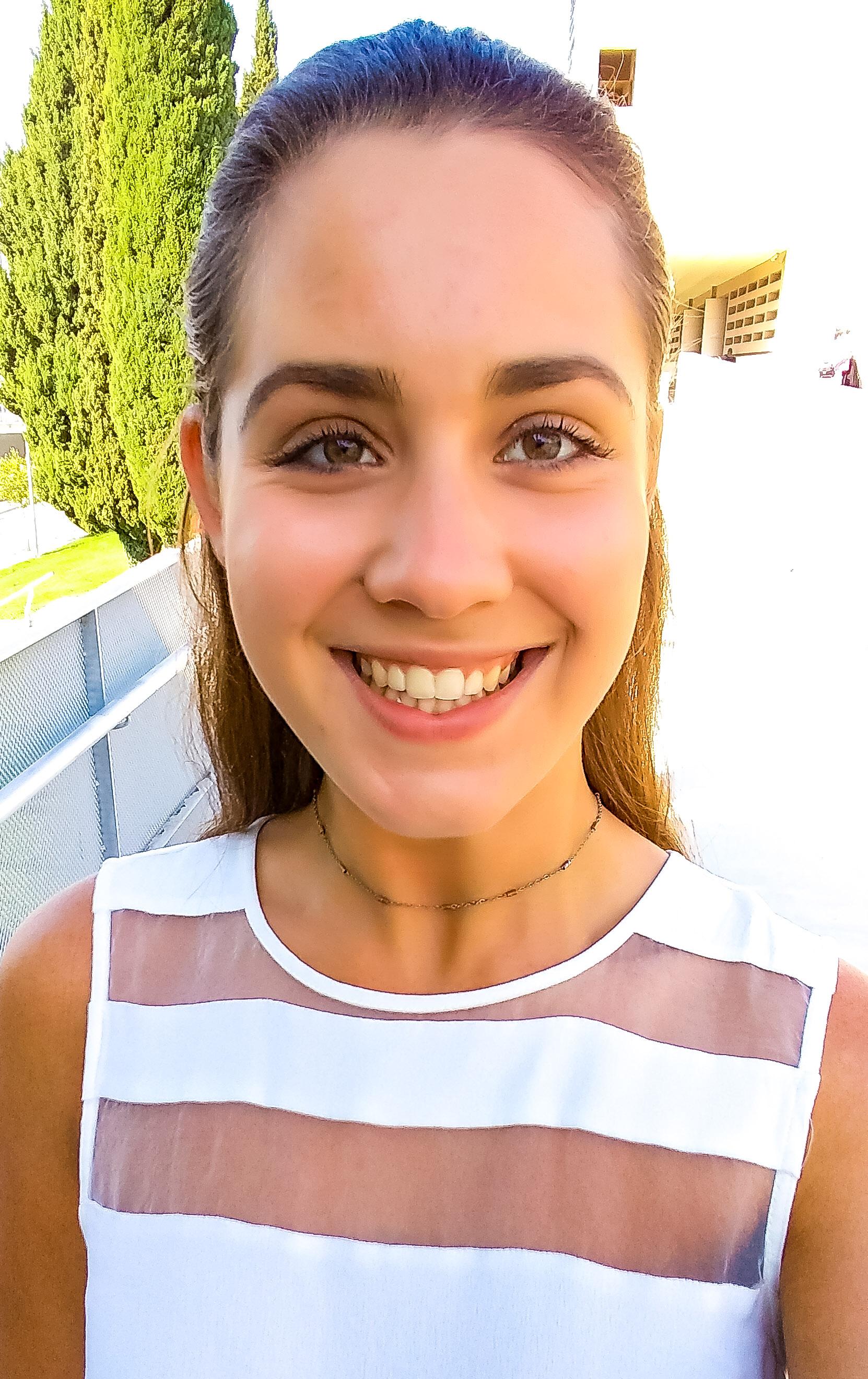 selfie of girl smiling in the sun