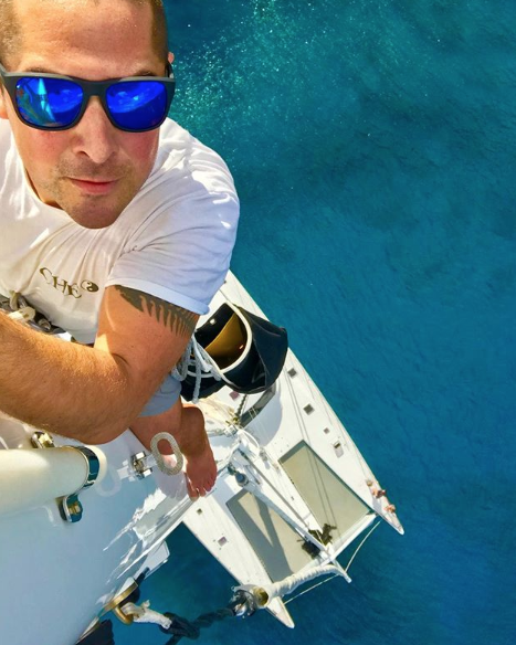 selfie of a man at the top of a mast wearing sunglasses