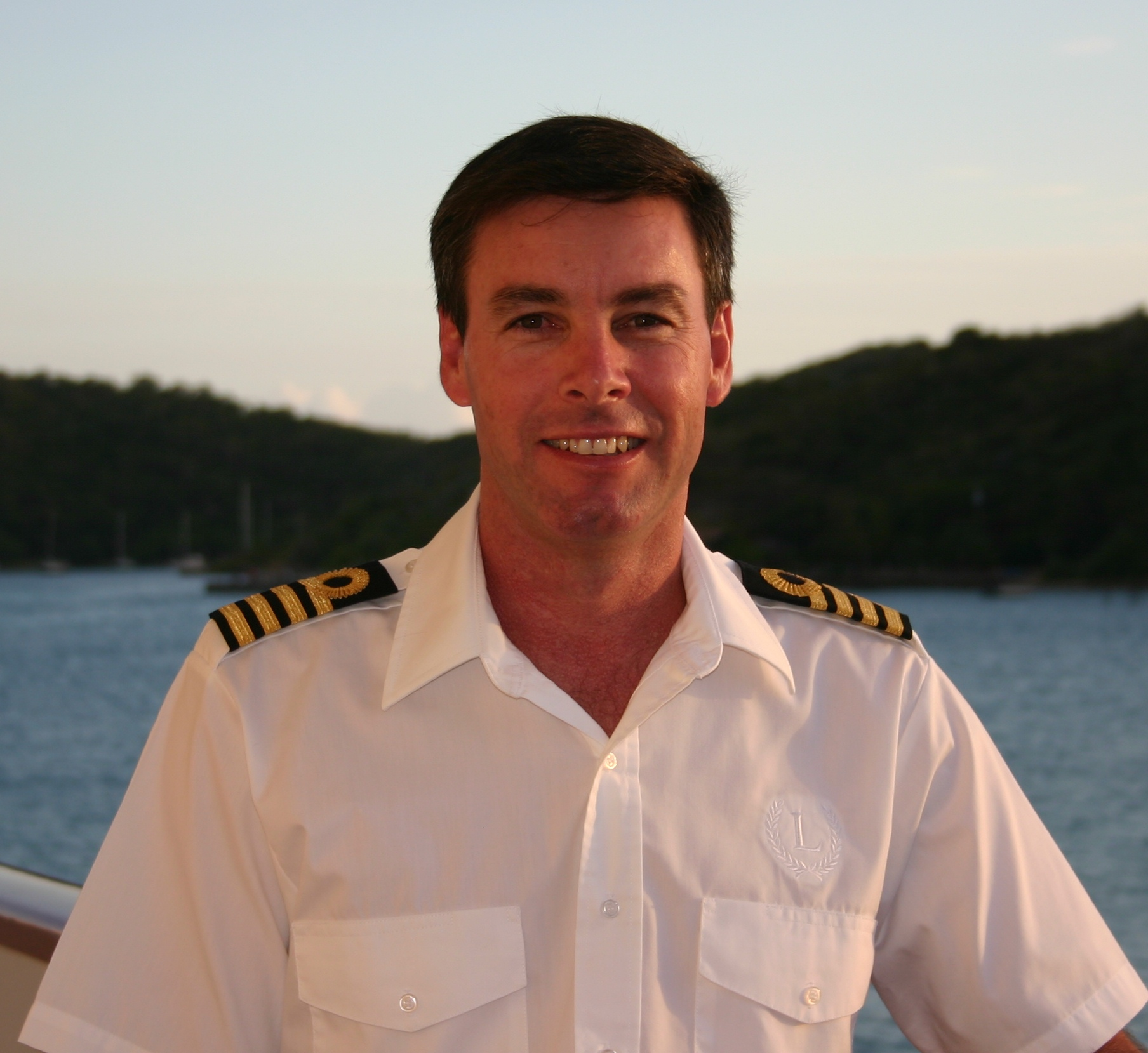 yacht captain smiling on boat on the sea