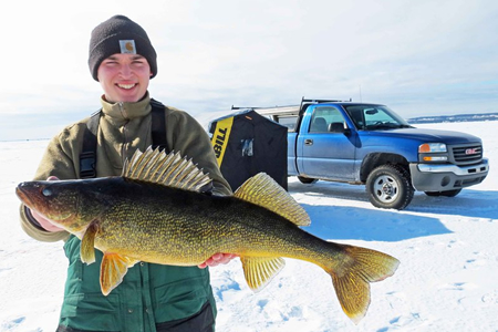 tim with walleye on ice