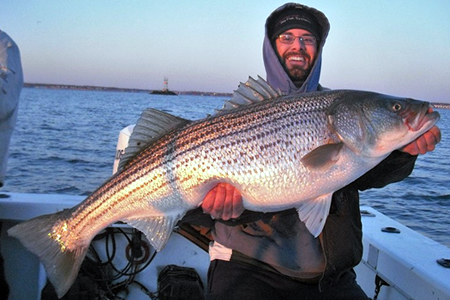chris with striped bass