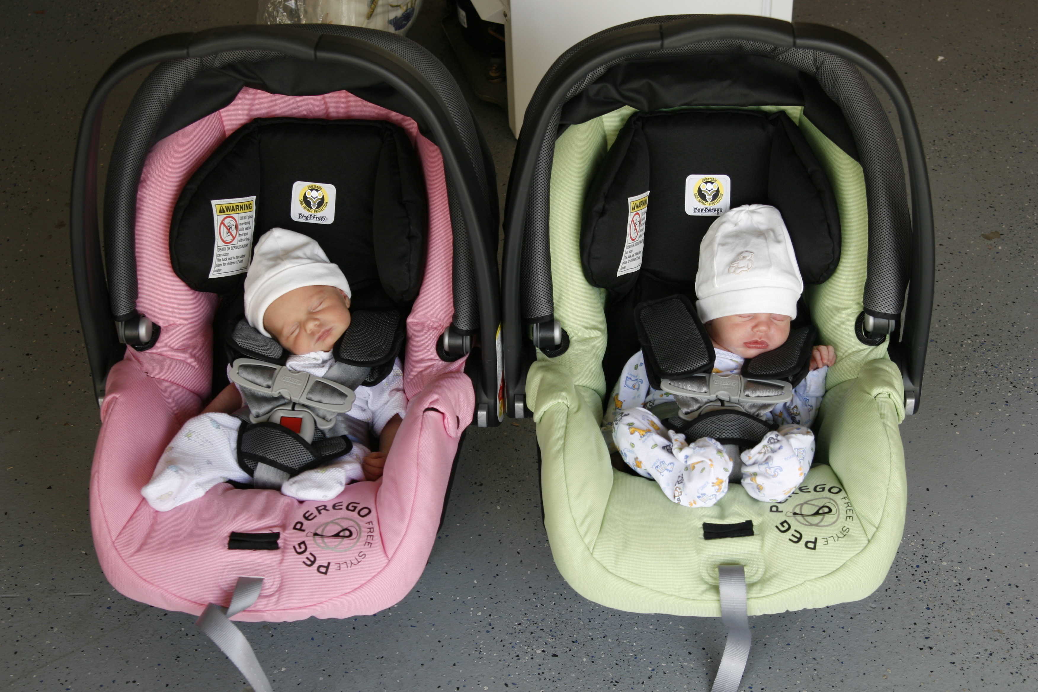 Tiny twins in car seats